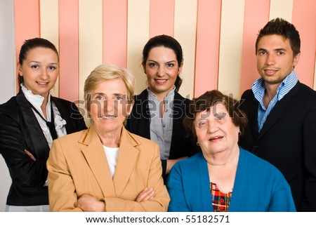 Happy group of business  young and senior people - stock photo