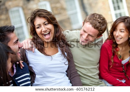 Happy group of casual friends having fun and smiling outdoors - stock photo