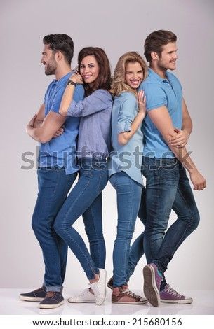 happy group of casual people men looking to sides and women smiling to the camera on grey background - stock photo