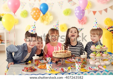 Happy group of children having fun at birthday party - stock photo