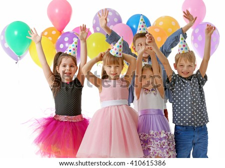 Happy group of children with having fun at birthday party, isolated on white - stock photo