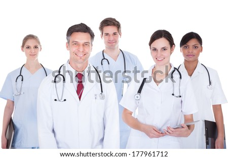Happy Group Of Doctors And Nurses With Stethoscope Standing Over White Background