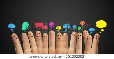Happy group of finger smileys with social chat sign and speech bubbles,icons. Fingers representing a social network.