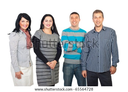 Happy group of four people standing in a row isolated on white background - stock photo