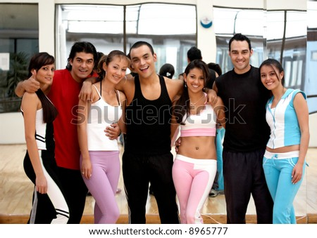 happy group of friends at the gym - stock photo