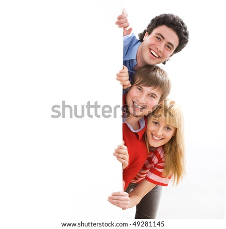 happy group of friends holding a banner - stock photo