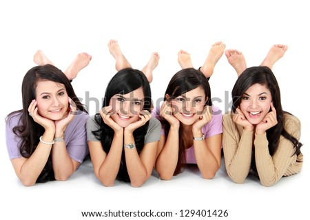 Happy group of friends on the floor and looking at camera - stock photo