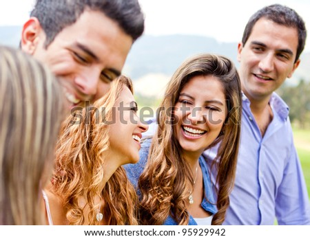 Happy group of friends talking and having fun outdoors - stock photo