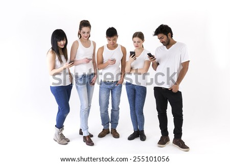 Happy group of friends using there Smartphone's. Mixed race group. Isolated on a white background.