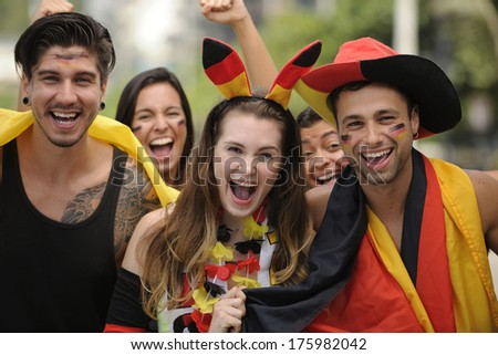Happy group of German sport soccer fans celebrating victory together. - stock photo