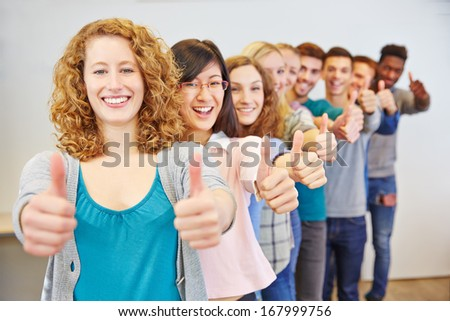 Happy group of many teenager congratulating with thumbs up - stock photo