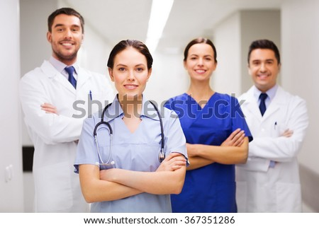 happy group of medics or doctors at hospital