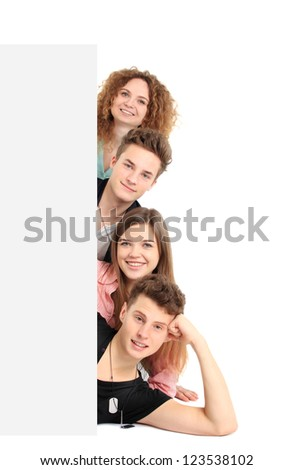 Happy group of people with a banner - isolated over a white background - stock photo