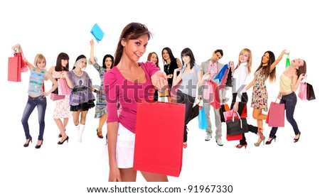 Happy group of shopping people holding bags - isolated over white - stock photo