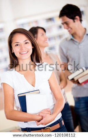 Happy group of students at the university - stock photo