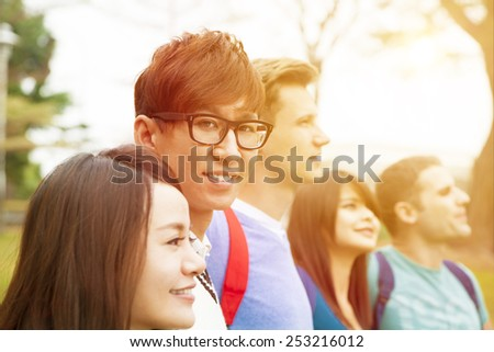 Happy group of students standing together - stock photo