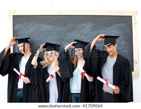 Happy group of teenagers celebrating after Graduation - stock photo