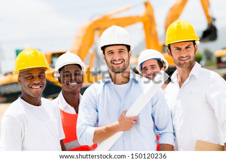 Happy group of working men at a construction site  - stock photo