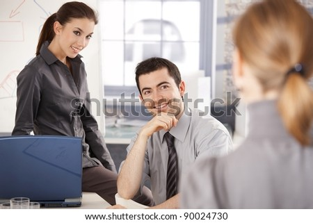 Happy group of young businesspeople working together, smiling.? - stock photo