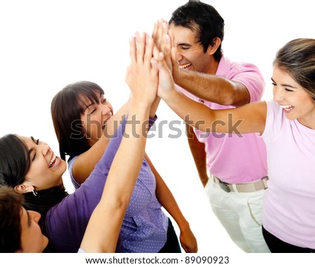 Happy group of young friends giving a high-five isolated over a white background - stock photo