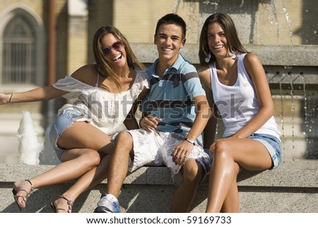 Happy group of young people, enjoying the sunny day - stock photo