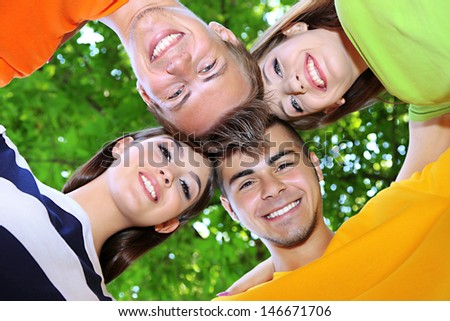 Happy group of young people in park - stock photo