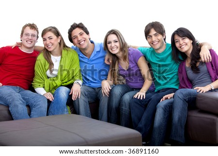 Happy group of young people sitting on the couch isolated