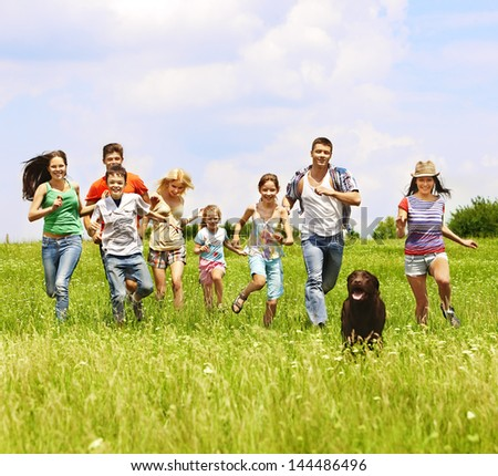 Happy group people summer outdoor with dog. - stock photo