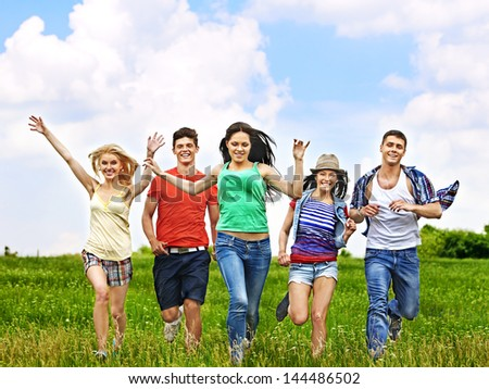 Happy group people with children summer outdoor. - stock photo