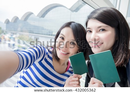 Happy group travel women hold passport and take a selfie. shot in hong kong, asian - stock photo