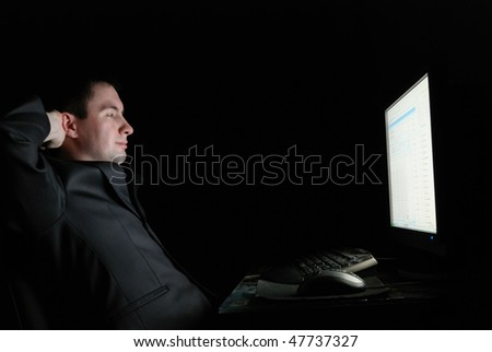 Happy guy in a jacket  with monitor - stock photo