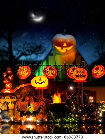 Happy Halloween image with lots of glowing jackolanterns in fantastical spooky environment - stock photo