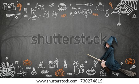 Happy Halloween With Girl Kid In Witch Costume Riding Broomstick On Spooky  Dark Black Chalkboard With