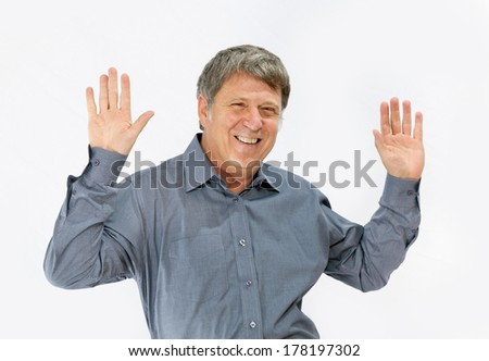 happy handsome man greets with hands with white background