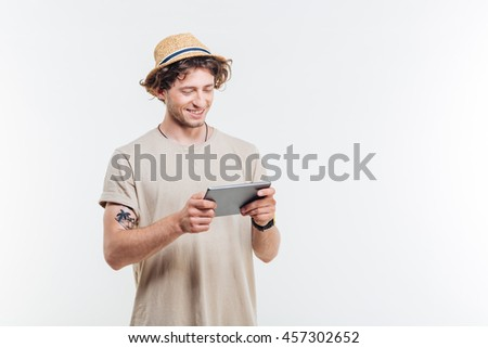 Happy handsome young man using tablet over white background - stock photo