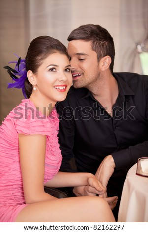 happy happy couple flirting at restaurant table - stock photo