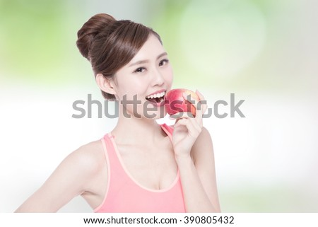 Happy health woman show apple benefit to health with nature green background, asian beauty