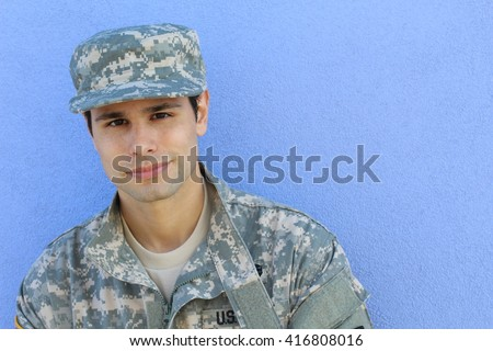 Happy healthy ethnic army soldier with copy space on the right - stock photo