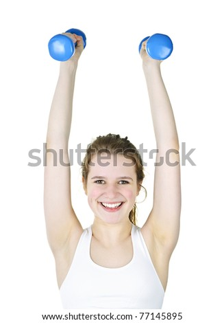 Happy healthy fit young woman lifting weights for fitness exercise - stock photo