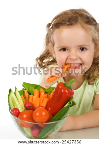 Happy healthy little girl eating vegetables - chomping a carrot - isolated - stock photo