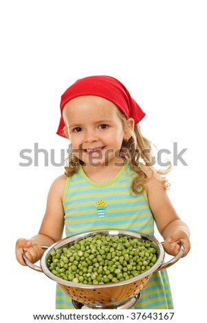 Happy healthy little girl with a bowl of fresh peas - isolated