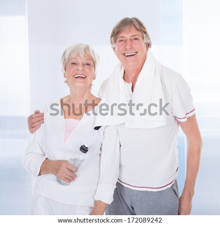 Happy Healthy Senior Couple With Towel And Water Bottle - stock photo