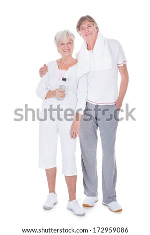 Happy Healthy Senior Couple With Towel And Water Bottle On White Background - stock photo
