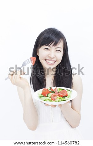 happy healthy woman with salad on white background