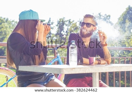 Happy hipster couple enjoying time together in nature.