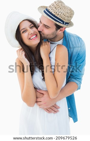 Happy hipster couple hugging and smiling on white background - stock photo