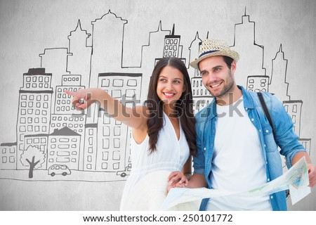 Happy hipster couple looking at map against white background