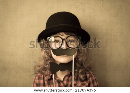 Happy hipster kid in studio - stock photo