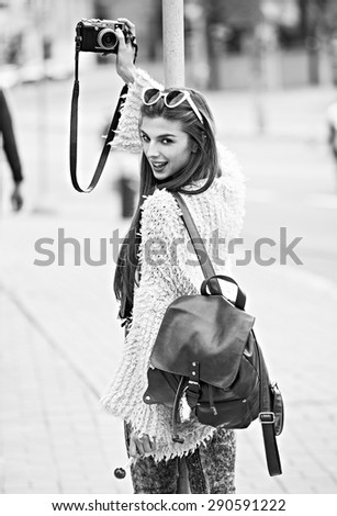 Happy hipster woman travel, she take photo and selfie by camera - stock photo