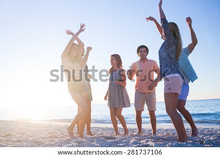 Happy hipsters drinking beer at the beach - stock photo